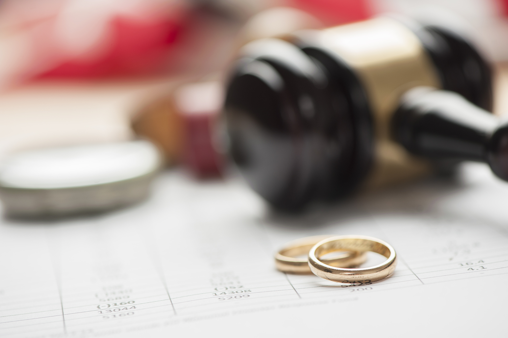 Gavel and wedding rings for divorce concept